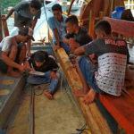 Boat in Komodo, dock work